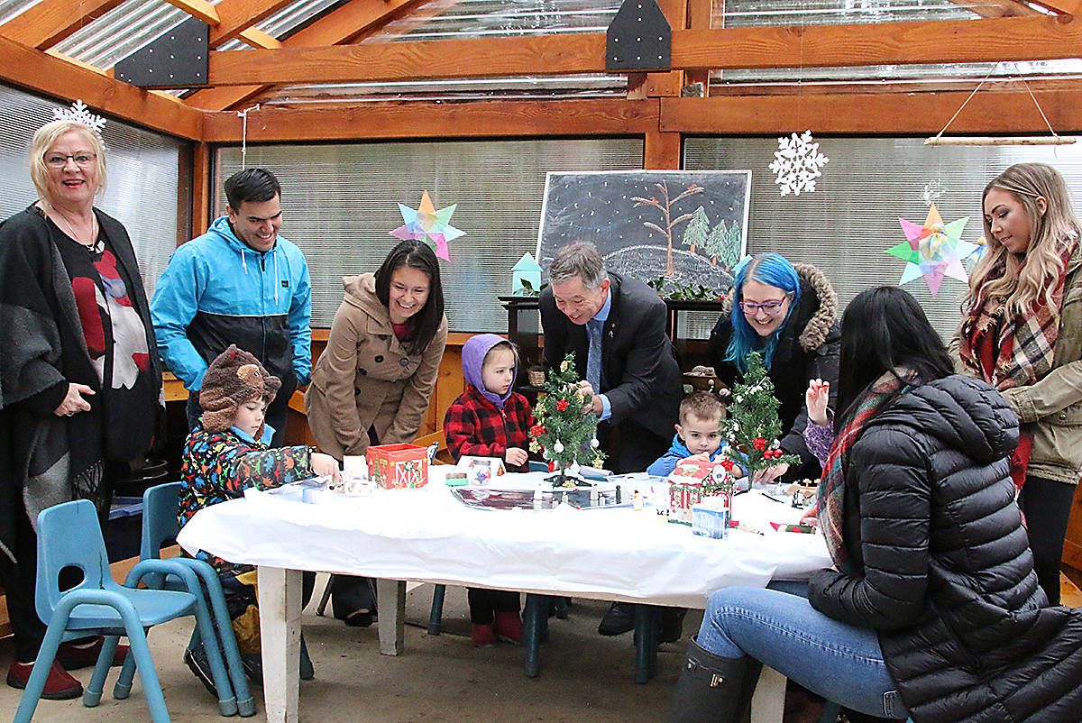 MLA Doug Routley, centre, enjoys some fun decorating a little tree with some of the children from Parkside. (Lexi Bainas/Citizen)